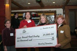 The Norwell Chamber gives the Norwell Food Pantry a big check. Photo by Tom Malames